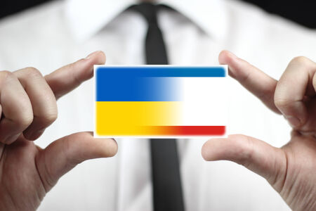Businessman holding a business card with Autonomous Republic of Crimea and Ukraine Flag photo