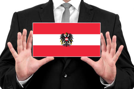 Businessman holding a business card with Austria Flag photo