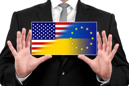Businessman holding a business card with Ukraine, EU and USA Flag photo