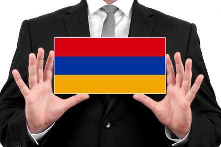 armenia: Businessman holding a business card with Armenia Flag