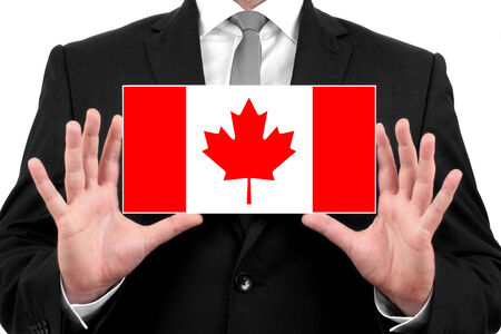Businessman holding a business card with Canada Flag photo