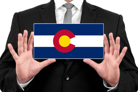 Businessman holding a business card with Colorado State Flag