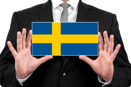 education in sweden: Businessman holding a business card with Sweden Flag