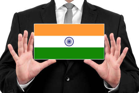 Businessman holding a business card with India Flag photo