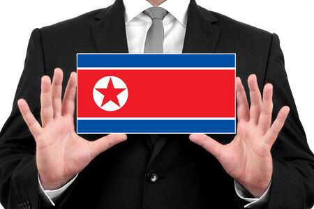 asian business meeting: Businessman holding a business card with North Korea Flag