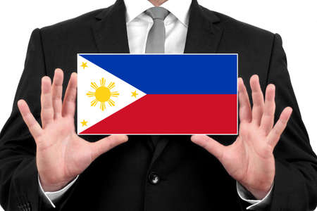 Businessman holding a business card with Philippines Flag Stock Photo - 26441777
