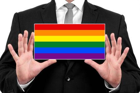 Businessman holding a business card with Rainbow Flag photo
