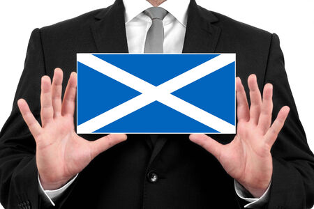 Businessman holding a business card with Scotland Flag photo