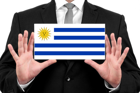 Businessman holding a business card with Uruguay Flag photo
