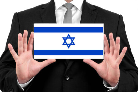 Businessman holding a business card with Israel Flag photo