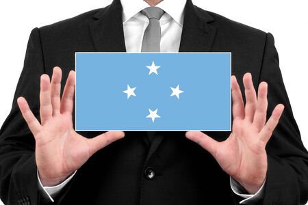 Businessman holding a business card with Micronesia Flag photo