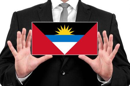 antigua flag: Businessman holding a business card with Antigua and Barbuda Flag