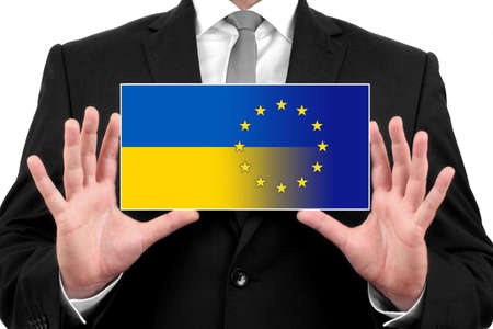 Businessman holding a business card with Ukraine and EU Flag photo