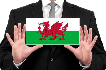 Businessman holding a business card with Wales Flag