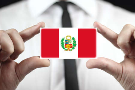 Businessman holding business card with Peru Flag photo