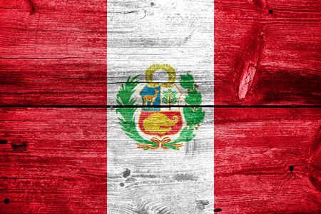 Peru Flag painted on old wood plank texture Stock Photo