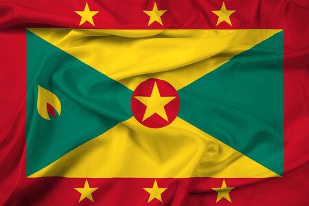 grenada: Waving Grenada Flag Stock Photo