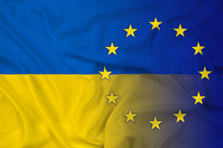 eu: Waving Ukraine and EU Flag Stock Photo