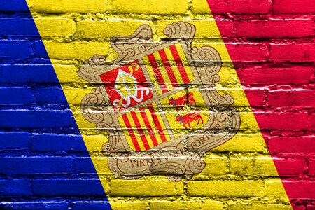 brick and mortar: Andorra Flag painted on brick wall