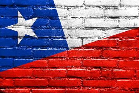 brick and mortar: Chile Flag painted on brick wall
