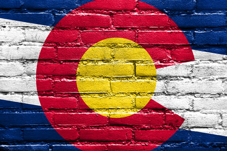 Colorado State Flag painted on brick wall photo