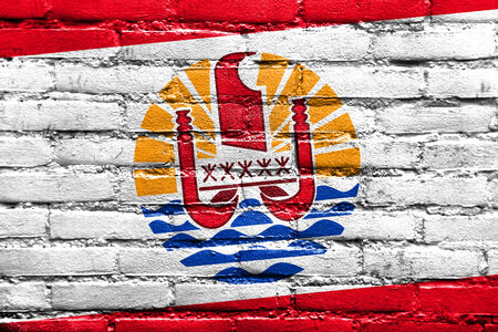 deteriorate: French Polynesia Flag painted on brick wall