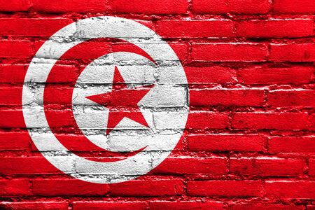 Tunisia Flag painted on brick wall photo