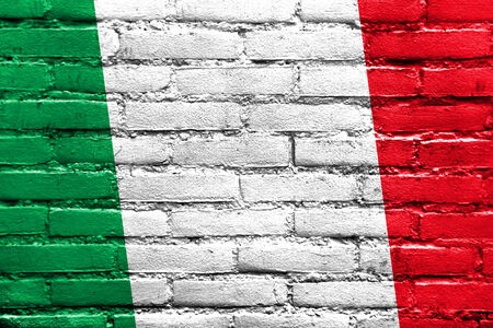 Italy Flag painted on brick wall Imagens