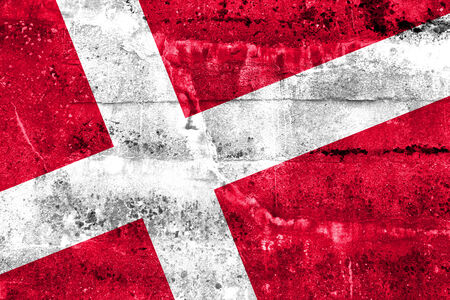brick and mortar: Denmark Flag painted on grunge wall Stock Photo