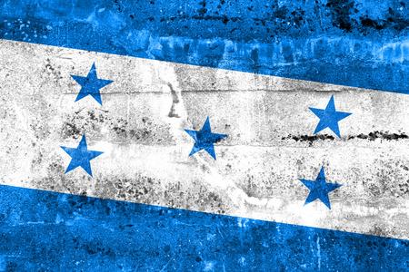 disintegrate: Honduras Flag painted on grunge wall Stock Photo