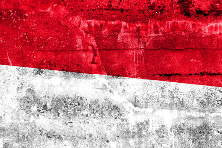 disintegrate: Indonesia Flag painted on grunge wall