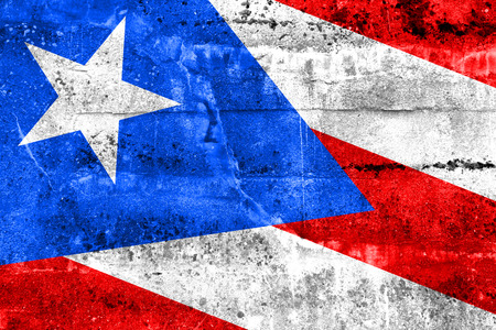 Puerto Rico Flag painted on grunge wall