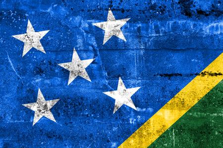 disintegrate: Solomon Islands Flag painted on grunge wall Stock Photo