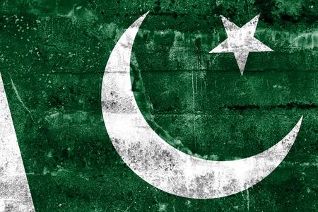 disintegrate: Pakistan Flag painted on grunge wall