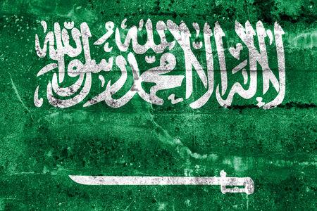 sheik: Saudi Arabia Flag painted on grunge wall Stock Photo
