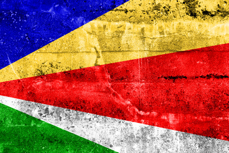 disintegrate: Seychelles Flag painted on grunge wall