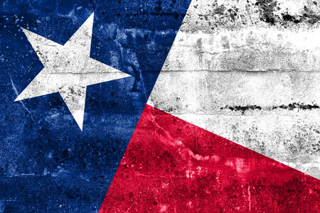 Texas State Flag painted on grunge wall photo