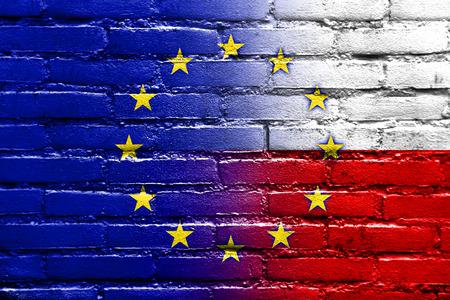 north atlantic treaty organization: Poland and European Union Flag painted on brick wall