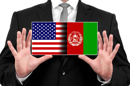 Businessman holding a business card with USA and Afghanistan Flag photo