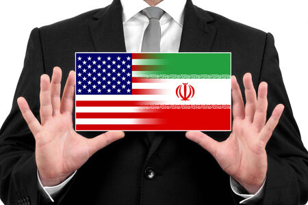Businessman holding a business card with USA and Iran Flag photo