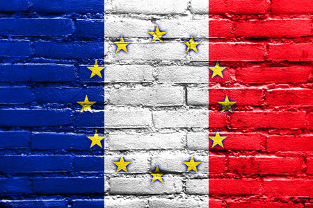 France and European Union Flag painted on brick wall photo