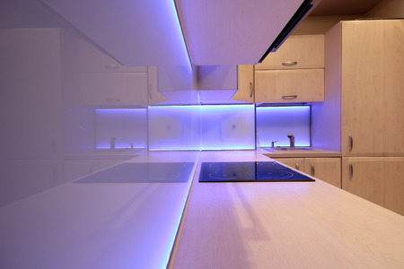 Modern luxury kitchen with purple LED lighting photo