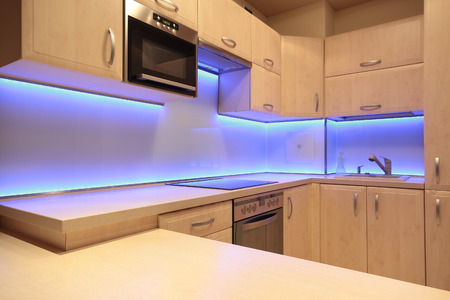 kitchen cabinets: Modern luxury kitchen with purple LED lighting
