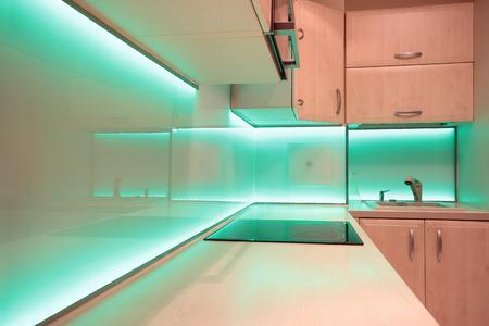 Modern luxury kitchen with green LED lighting photo