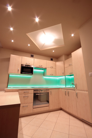 Modern luxury kitchen with green LED lighting photo