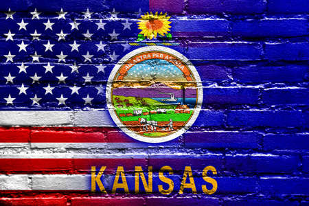 consolidated: USA and Kansas State Flag painted on brick wall