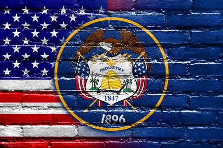 USA and Utah State Flag painted on brick wall Reklamní fotografie