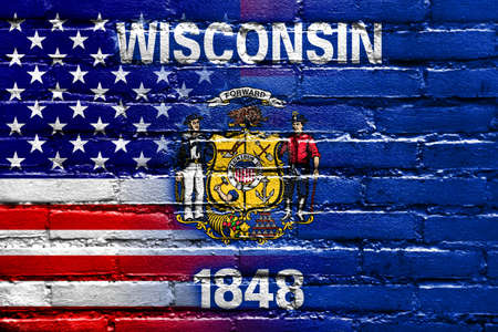wisconsin state: USA and Wisconsin State Flag painted on brick wall