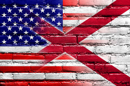 consolidated: USA and Alabama State Flag painted on brick wall