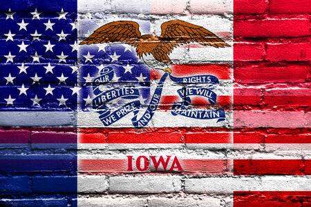 USA and Iowa State Flag painted on brick wall photo